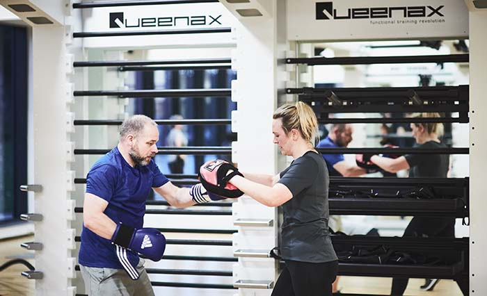 Instructor and student boxing