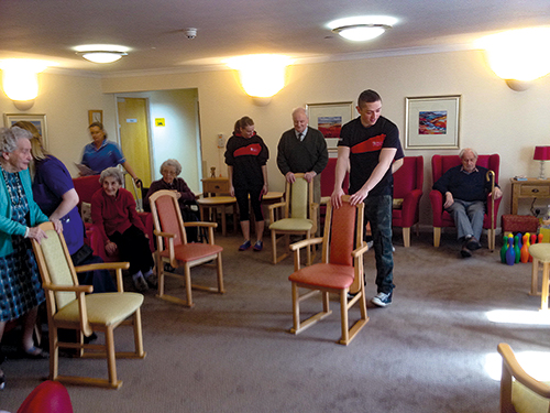 Sports Students Helping the Elderly in Care Homes