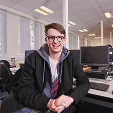 computing student, harry main, in a classroom