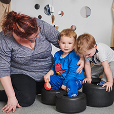 children playing with their support worker