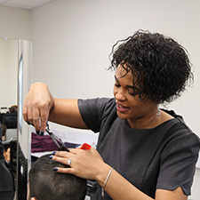 Hairdressing student cutting a clients hair